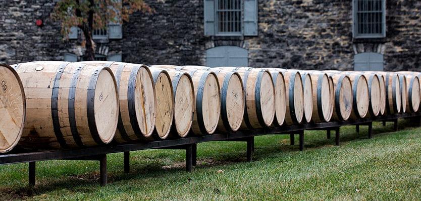 Row of bourbon barrels